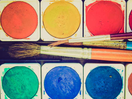 creativeness: Vintage looking Painting tools colour palette and brushes Stock Photo