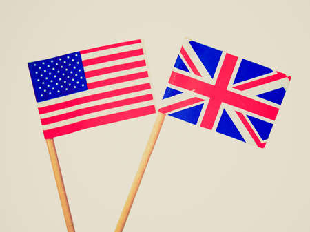 Vintage looking The national flag of the United Kingdom (UK) and United States of America (USA) - isolated over white background - selective focus photo