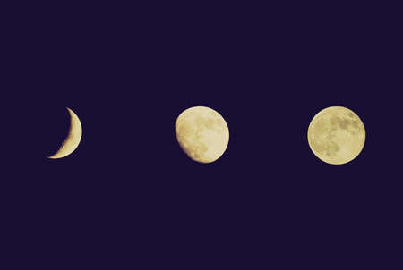 Vintage looking Various moon phases from crescent to full moon, as seen from Planet Earth over dark black sky at night photo