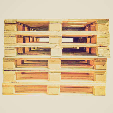 Vintage looking Pile of pallets isolated over white background Stock Photo - 27183859