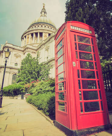Vintage looking Traditional red telephone box in London UK photo