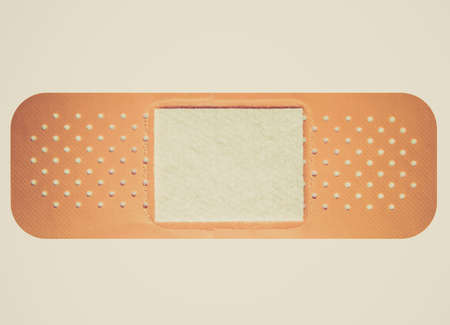 Vintage looking Band aid isolated over a white background Imagens