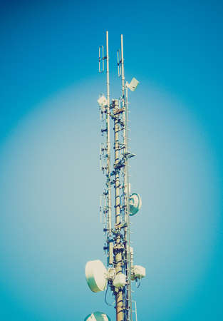 Vintage looking Communication tower radio mast with antenna aerial photo