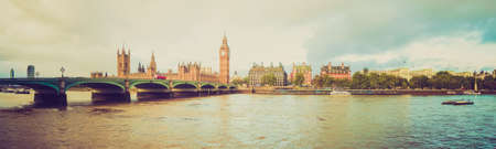 Vintage looking Panoramic view of the River Thames, Houses of Parliament and the Big Ben, Westminster Bridge in London photo