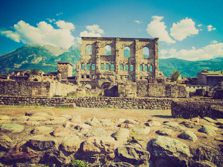 aosta: Vintage looking Ruins of the Roman Theatre in Aoste Italy Stock Photo