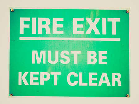 wayout: Vintage looking Fire exit sign with white text over green Stock Photo