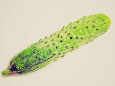 english cucumber: Vintage looking English cucumber vegetable isolated over a white background