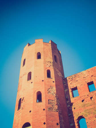 torri: Vintage looking Palatine towers (Porte Palatine) ancient roman town gates Turin Stock Photo