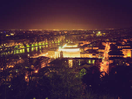 Vintage looking Fiume Po (River Po) in Turin, Italy - at night photo