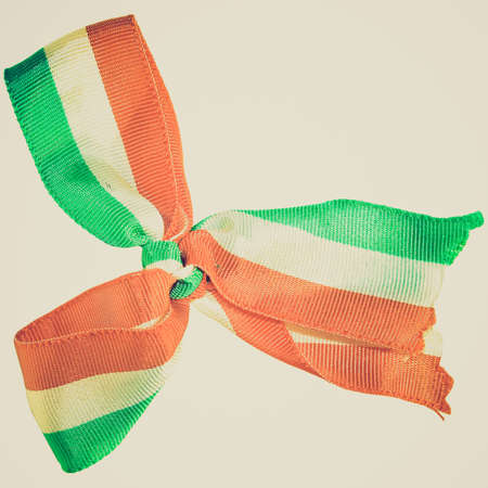 Vintage retro looking The national flag on a cockade isolated over white background - Cote dIvoire - Ireland - India photo