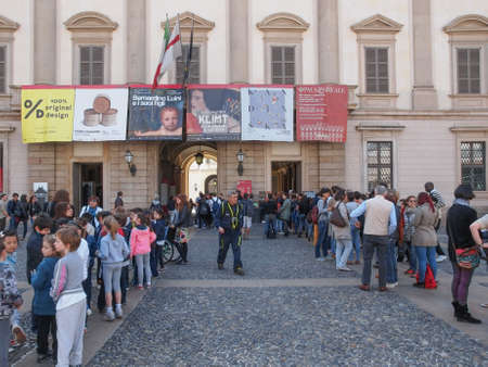 queueing: MILAN, ITALY - APRIL 10, 2014: People queueing in front of Palazzo Reale exhibition room to visit a temporary exhibition Editorial