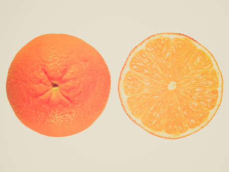 Vintage looking Orange fruit in and out view isolated over white photo