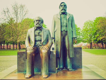 Vintage looking Marx and Engels statue in Marx-Engels-Forum, Alexanderplatz, Berlin