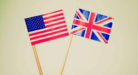 Vintage looking The national flag of the United Kingdom (UK) and United States of America (USA) photo