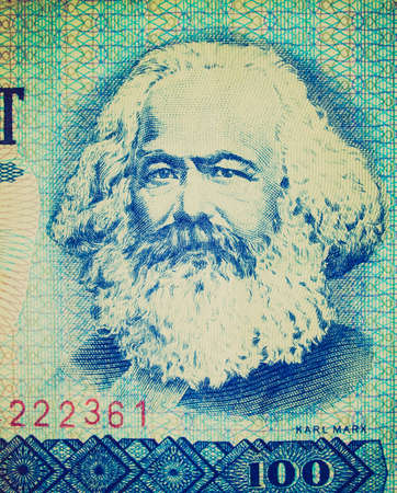marx: Vintage looking 100 Mark banknote from the DDR (East Germany) with Karl Marx with 1 Mark coin - Note: no more in use since german reunification in 1989 Editorial