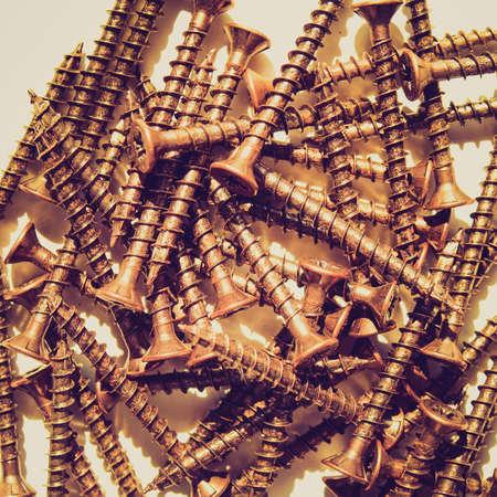 ferreteria: Detalle de �poca en busca de tornillos de bronce para trabajos en madera