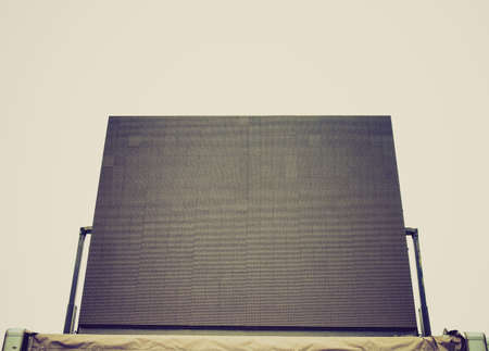 Vintage looking Large tv maxi screen colour display used for live gig event - isolated over white background photo