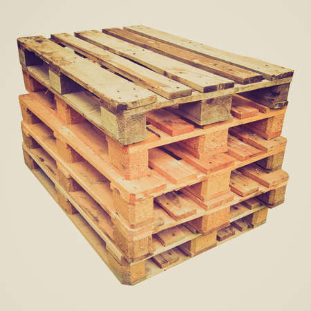 skids: Vintage looking Pile of wooden pallets or skids - isolated over white background