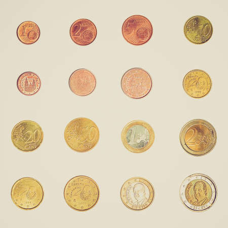 Vintage looking Euro coins including both the international and national side of Spain photo