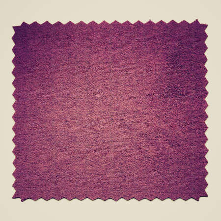 sampler: Vintage looking A purple fabric sample isolated over white background Stock Photo