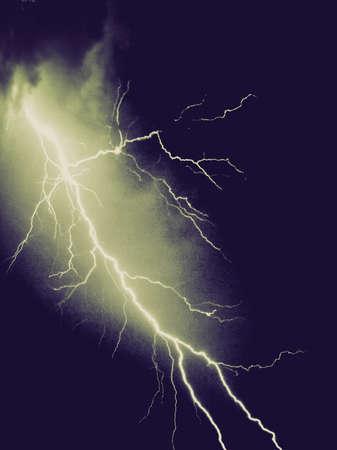 Vintage looking Bright lightning in the dark night sky