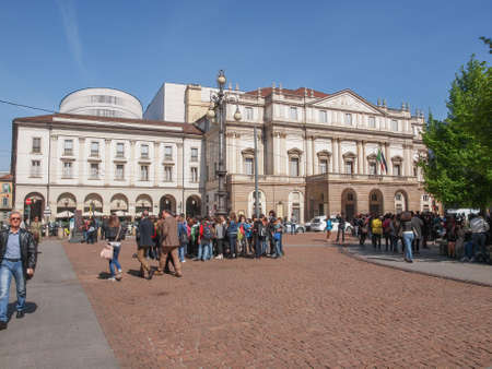 scala: MILAN, ITALY - APRIL 10, 2014: Tourists in front of  Teatro Alla Scala aka La Scala world famous opera house Editorial