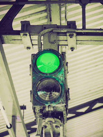 authorisation: Vintage looking Green light on a traffic light or semaphore Stock Photo