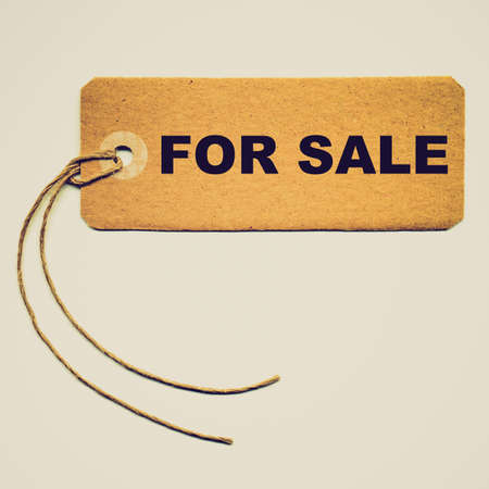 Vintage looking Price tag with string isolated over white photo