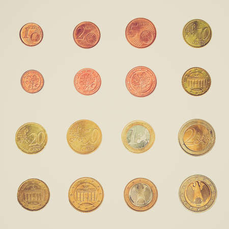 Vintage looking Euro coins including both the international and national side of Germany photo
