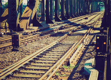 Vintage looking Detail of Railway railroad tracks for trains photo