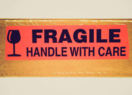Vintage looking Detail of a fragile corrugated cardboard packet Stock Photo