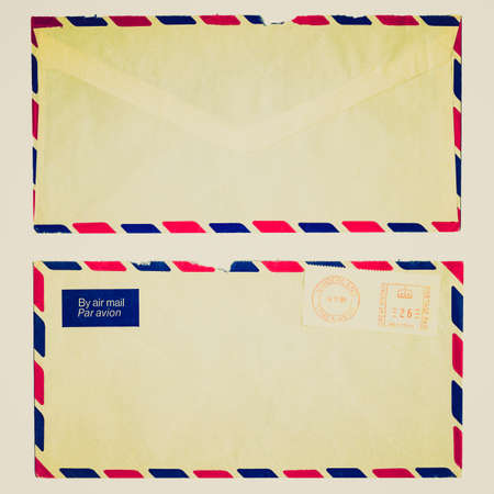 Vintage looking Letter or small packet envelope isolated over white photo