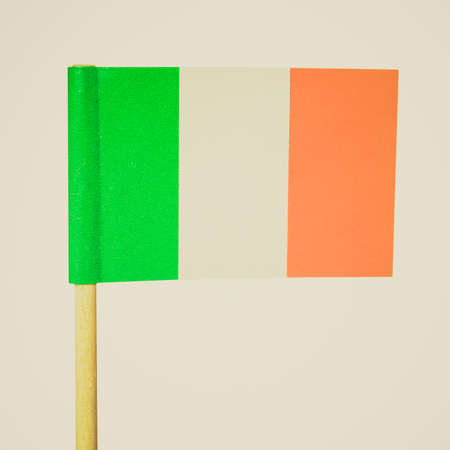 ie: Vintage looking The national Irish flag of Ireland (IE) - isolated over white