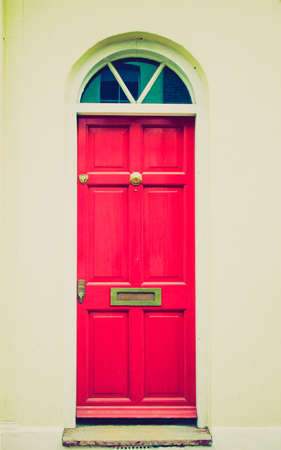 Vintage looking Brightly coloured traditional English house door in London photo