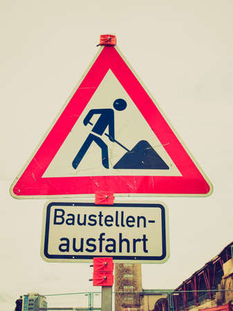 Vintage looking Road works sign for construction works in\ progress - in German