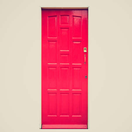 Vintage looking A traditional entrance door of a British house - isolated over white  photo