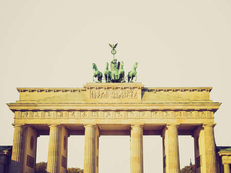 Vintage looking Brandenburger Tor (Brandenburg Gate), famous landmark in Berlin, Germany - isolated over white  photo