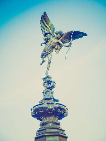 piccadilly: Vintage looking Piccadilly Circus with statue of Anteros aka Eros in London, UK