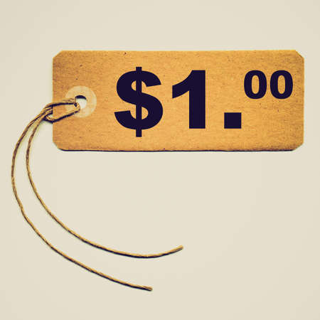 Vintage looking Price tag with string isolated over white - 1 Dollar