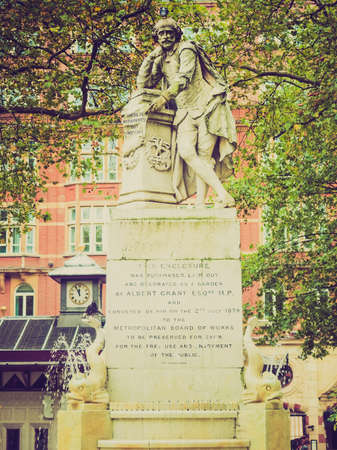 Vintage looking Statue of William Shakespeare (year 1874) in Leicester square London UK
