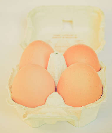 Vintage looking Detail of eggs in a carton box