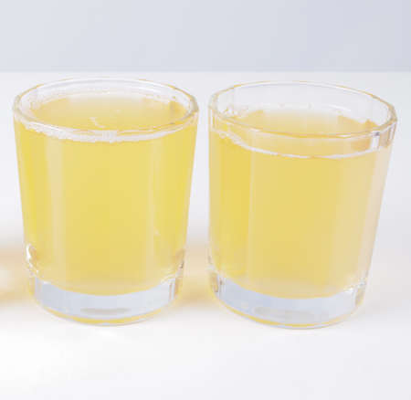 continental breakfast: Glasses of pineapple juice on continental breakfast table