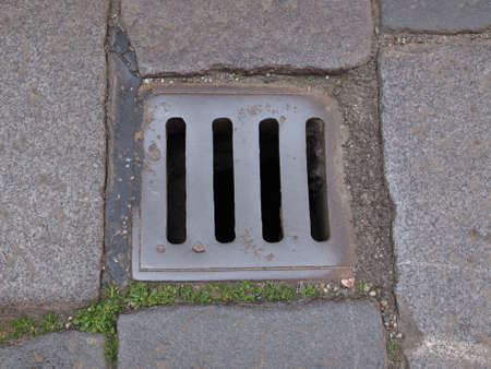 Detail of a manhole in the street photo