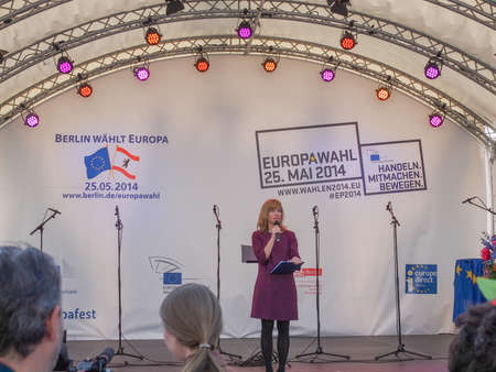 forthcoming: BERLIN, GERMANY - MAY 09, 2014: Marion Pinkpank from Radio Berlin moderating the Europafest at Brandenburg Gate for the forthcoming European elections (Europawahl). Berlin waehlt Europa means Berlin elects Europe. Handeln Mitmachen Bewegen means Act Join