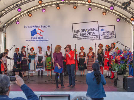 forthcoming: BERLIN, GERMANY - MAY 09, 2014: Bulgarian Voices Choir at the Europafest at Brandenburg Gate for the forthcoming European elections (Europawahl) moderated by Marion Pinkpank from Radio Berlin
