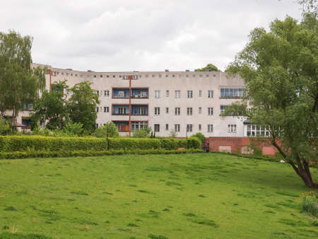 taut: BERLIN, GERMANY - MAY 11, 2014: The Hufeisensiedlung (meaning Horseshoe housing estate) aka Grosssiedlung Britz designed by Bruno Taut and Martin Wagner in 1925 is a masterpiece of early modernism Editorial