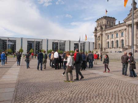 bundes: BERLIN, GERMANY - MAY 09, 2014: People visiting the Band des Bundes complex of government buildings near the Reichstag (German parliament) build in 1995 following the reunification of Germany