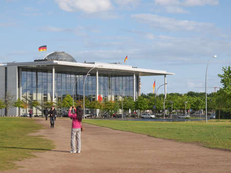bundes: BERLIN, GERMANY - MAY 11, 2014: People visiting the Band des Bundes complex of government buildings near the Reichstag (German parliament) build in 1995 following the reunification of Germany Editorial