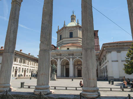 residents: MILAN, ITALY - MAY 16, 2011: Le Colonne square in front of the roman ruins is a popular meeting point for both tourists and residents