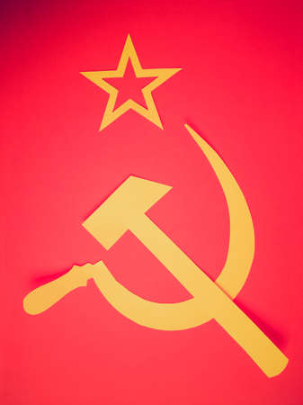 hammer and sickle: Vintage retro looking Communist CCCP Flag with hammer and sickle, symbols of communism, yellow over red Stock Photo